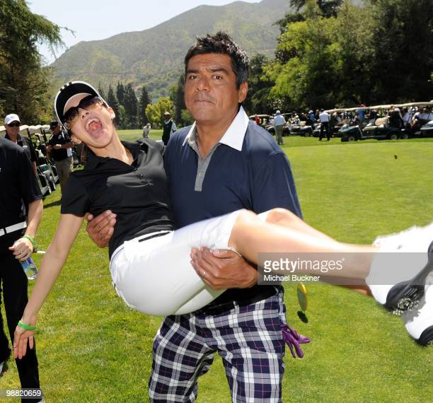 Comedian George Lopez picks up actress Aimee Garcia before teeing off at the 3rd Annual George Lopez Celebrity Golf Classic at the Lakeside Golf Club...