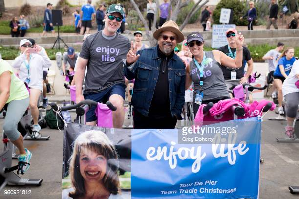 Comedian George Lopez poses for a picture with riders at the 6th Annual Tour de Pier at Manhattan Beach Pier on May 20 2018 in Manhattan Beach...