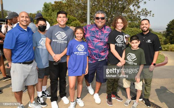 Comedian George Lopez poses with Boys & Girls Club kids at the 8th annual Cedric The Entertainer Golf Classic at Spanish Hills Country Club on August...