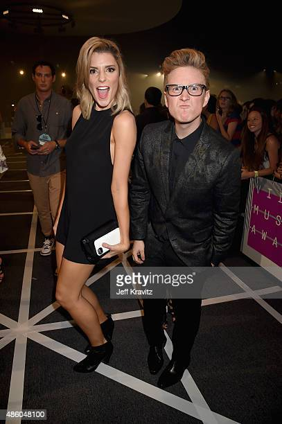 Comedian Grace Helbig and TV personality Tyler Oakley attend the 2015 MTV Video Music Awards at Microsoft Theater on August 30 2015 in Los Angeles...