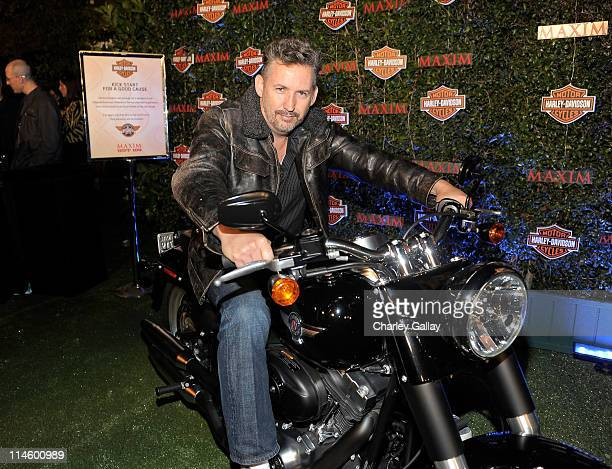 Comedian Harland Williams turns the key on a HarleyDavidson to raise money for Harley's Heroes at the 2010 Maxim Hot 100 Party held at Paramount...
