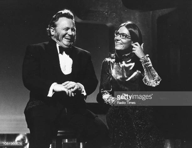 Comedian Harry Secombe and singer Nana Mouskouri sharing a joke on the set of a television show September 18th 1971
