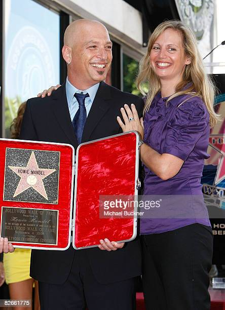 Comedian Howie Mandel and wife Terry Soil pose with Mandel's star on the Hollywood Walk of Fame on September 4 2008 in Los Angeles California