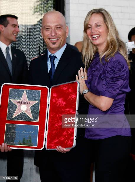 Comedian Howie Mandel and wife Terry Soil pose with Mandel's star on the Hollywood Walk of Fame on September 4 2008 in Hollywood California