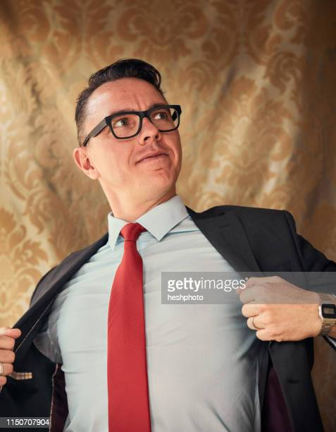 comedian in superhero gesture - heshphoto stock pictures, royalty-free photos & images