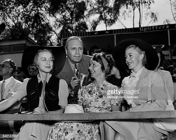 Comedian Jack Benny and actress Ginger Rogers attend a Polo Match in Los Angeles California