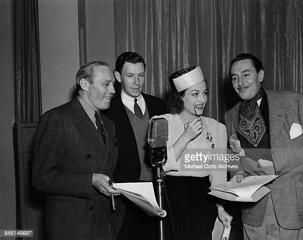 Comedian Jack Benny at a radio show with actor George Murphy and actress Joan Crawford in Los Angeles California