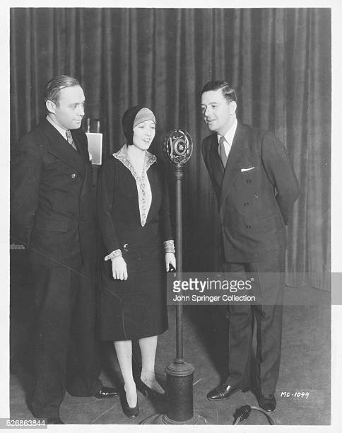 Comedian Jack Benny listens to Bessie Love and Charles King sing Lucky Me and Lovable You during a radio broadcast