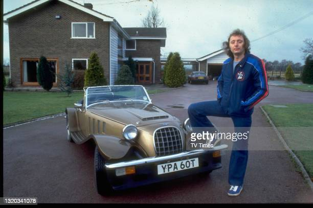 Comedian Jasper Carrott photographed at home with his Panther Lima sports car, circa 1979.