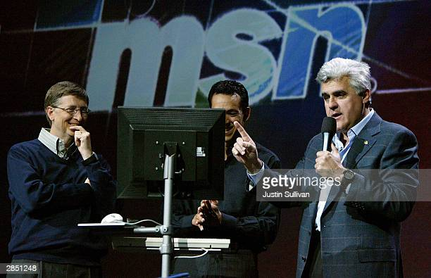 Comedian Jay Leno gestures as he speaks during a keynote address by Microsoft chairman Bill Gates at the Consumer Electronics Show January 7 2004 in...