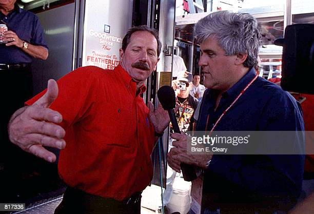 Comedian Jay Leno interviews NASCAR driver Dale Earnhardt for an NBC television show at Homestead Speedway Florida November 13 1999