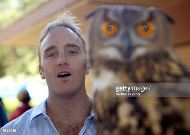 Comedian Jay Mohr poses with a Eurasian Eagle Owl during the 25th annual Beastly Ball at the Los Angeles Zoo on June 18, 2005 in Los Angeles,...