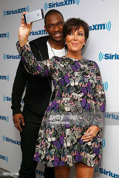 Comedian Jay Pharoah and TV Personality Kris Jenner wearing a Valentino dress pose for selfies at the SiriusXM Studios on June 5 2014 in New York City