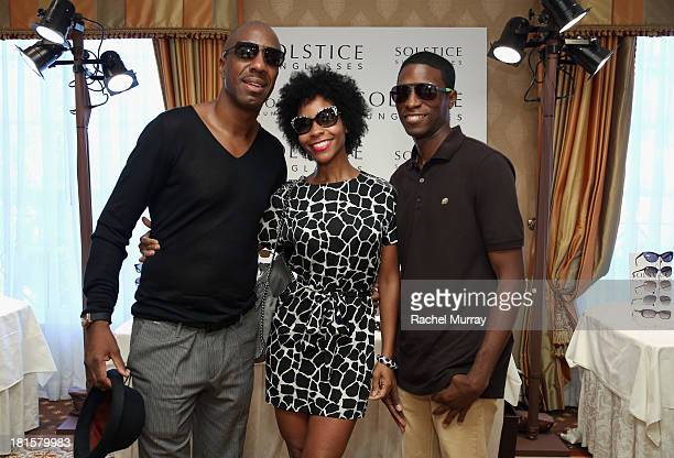 Comedian JB Smoove in Hugo Boss 454 sunglasses wife Shahidah Omar in Juicy Couture 546 sunglasses and son in Marc by Marc Jacobs 363 sunglasses pose...