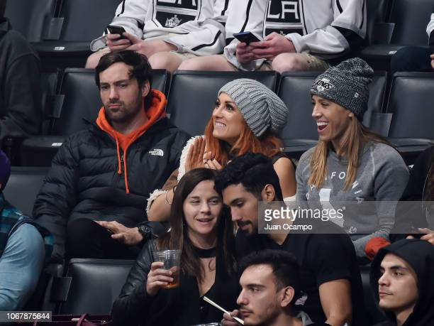 Comedian Jeff Dye Becky Lynch of the WWE and gym athlete Lauren Gravatt watch while attending the game between the Carolina Hurricanes and the Los...