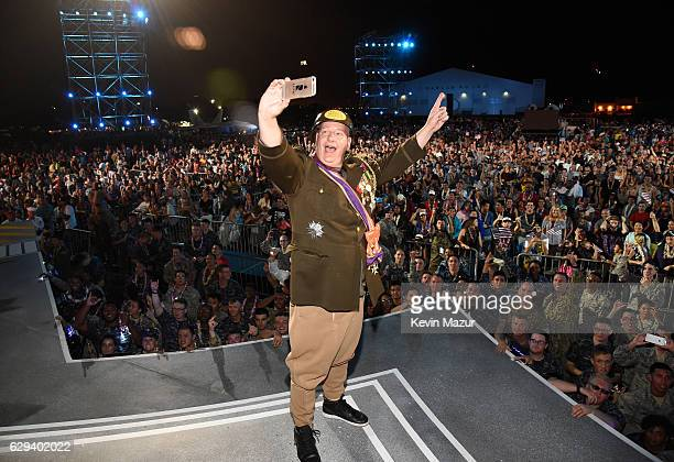 Comedian Jeff Ross takes a selfie with service men and women onstage during 'Spike's Rock the Troops' event held at Joint Base Pearl Harbor Hickam on...