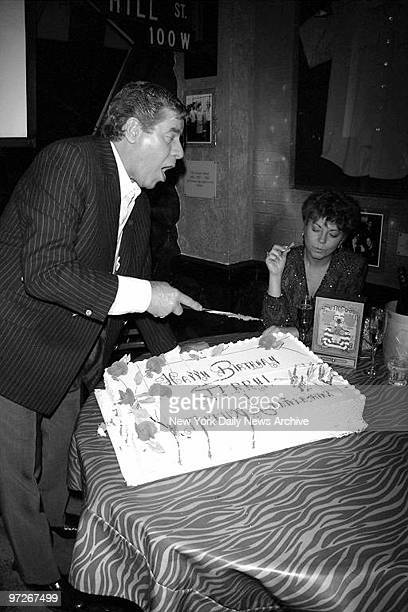 Comedian Jerry Lewis cuts his cake as his wife Sam looks on during celebration of his 69th birthday at Planet Hollywood