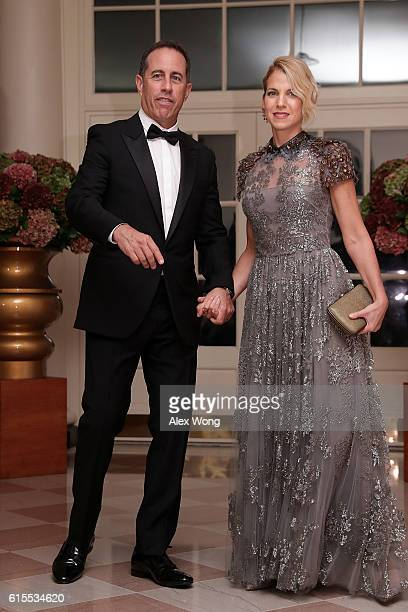 Comedian Jerry Seinfeld and his wife Jessica Seinfeld arrive at the White House for a state dinner October 18 2016 in Washington DC US President...