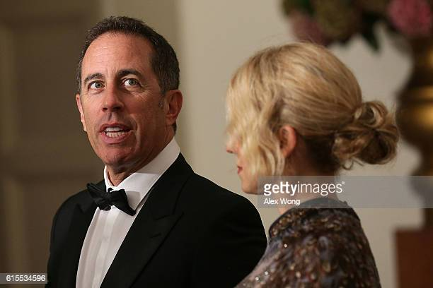 Comedian Jerry Seinfeld and his wife Jessica Seinfeld speak to members of the media as they arrive at the White House for a state dinner October 18...
