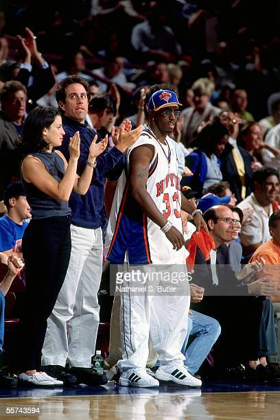 Comedian Jerry Seinfeld and Sean Combs cheer as they stand courtside in Game six of the 1999 NBA Eastern Conference Finals between the Indiana Pacers...