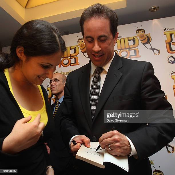 Comedian Jerry Seinfeld autographs a copy of his book 'Seinfeld' after his press conference ahead of the Israeli premiere of the Bee Movie November...