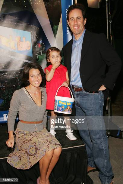 Comedian Jerry Seinfeld his wife Jessica and daughter Sascha attend the Shark Tale premiere at Central Park's Delacorte Theater on September 27 2004...