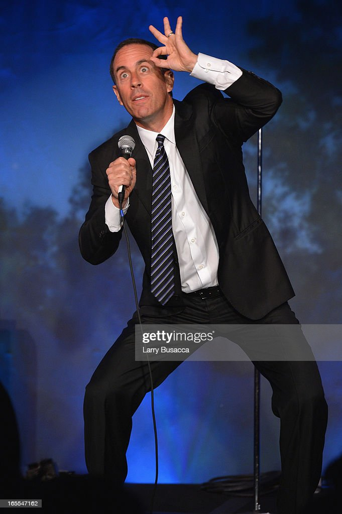 Comedian Jerry Seinfeld preforms during SeriousFun Children's Network event honoring Liz Robbins with celebrity guests at Pier Sixty at Chelsea Piers on April 4, 2013 in New York City.