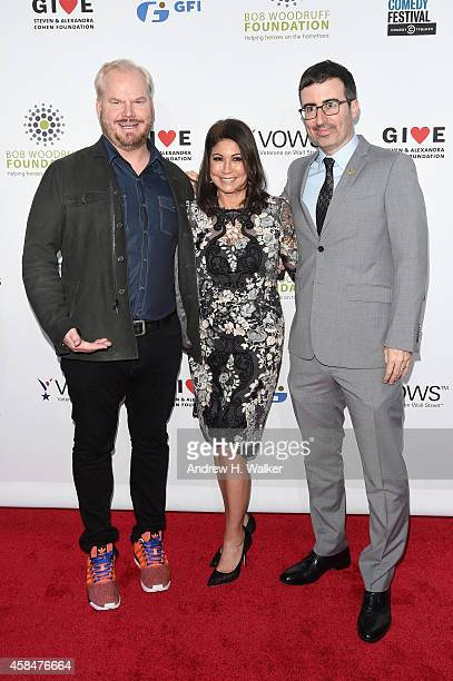 Comedian Jim Gaffigan Caroline Hirsch and comedian John Oliver attend 2014 Stand Up For Heroes at Madison Square Garden on November 5 2014 in New...