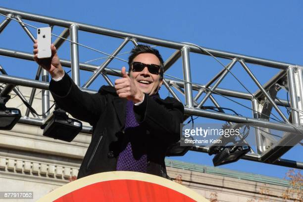 Comedian Jimmy Fallon gives a thumbs up on Central Park West during the annual Macy's Thanksgiving Day parade on November 23 2017 in New York City...