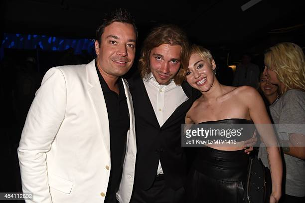 Comedian Jimmy Fallon My Friend's Place representative Jesse Helt and recording artist Miley Cyrus attends the 2014 MTV Video Music Awards at The...