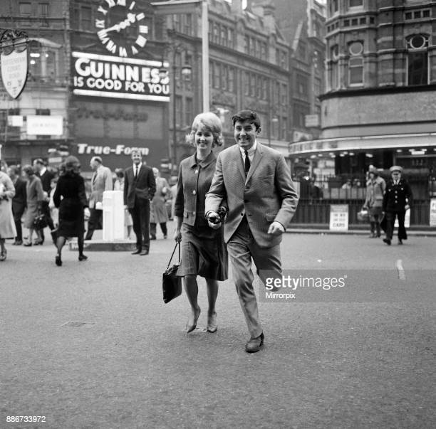 Comedian Jimmy Tarbuck aged 23 with his wife Pauline also 23 on a shopping spree before returning home to Liverpool 28th October 1963