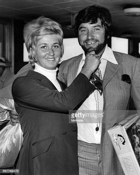 Comedian Jimmy Tarbuck flew into London airport today sporting a beard With his wife Pauline October 1969 P006224