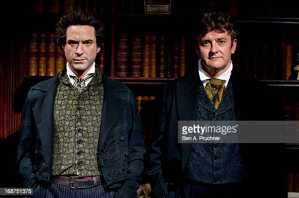 Comedian Joe Pasquale inspects Robert Downey Junior's Sherlock Holmes wax figure at Madame Tussauds on May 14 2013 in London England Pasquale is set...
