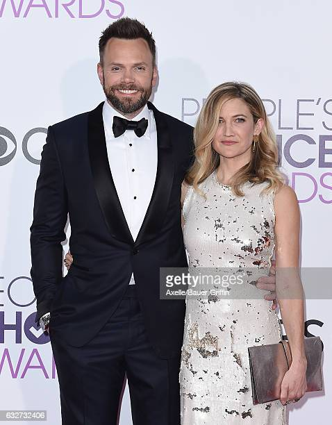 Comedian Joel McHale and Sarah Williams arrive at the 2017 People's Choice Awards at Microsoft Theater on January 18 2017 in Los Angeles California