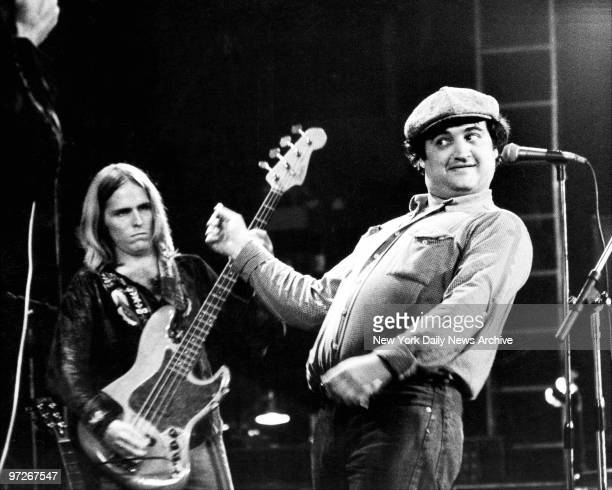Comedian John Belushi clowns on stage with the Allman Brothers Band during concert at the Capitol Theater