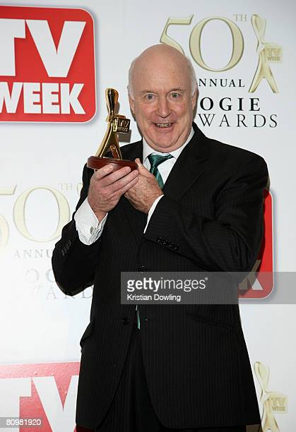 TV comedian John Clarke poses with his Lifetime Achievement Award award backstage in the Media Room at the 50th Annual TV Week Logie Awards at the...