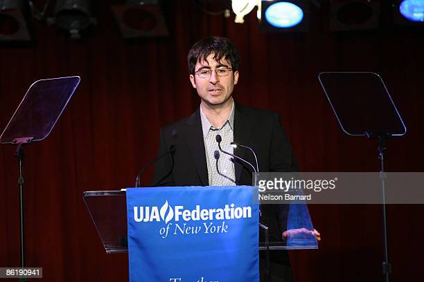 Comedian John Oliver addresses the audience at the UJA Federation event to honor Doug Herzog at BB Kings on April 23 2009 in New York City