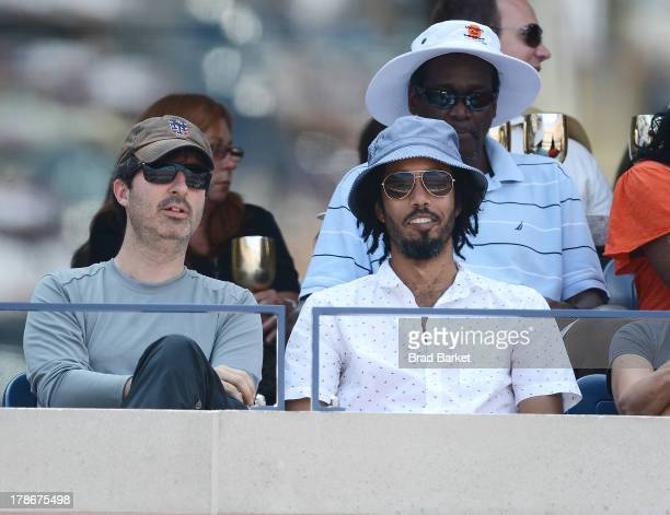 Comedian John Oliver and Wyatt Cenac attend the Moet Chandon Suite at the USTA Billie Jean King National Tennis Center on August 30 2013 in New York...