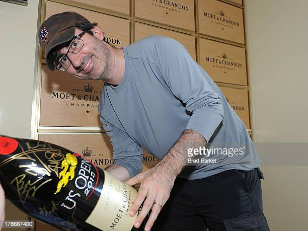 Comedian John Oliver attends the Moet Chandon Suite at the USTA Billie Jean King National Tennis Center on August 30 2013 in New York City