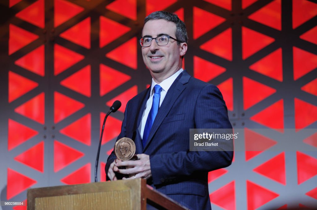 Comedian John Oliver of Last Week Tonight with John Oliver accepts Peabody award onstage during The 77th Annual Peabody Awards Ceremony at Cipriani Wall Street on May 19, 2018 in New York City.