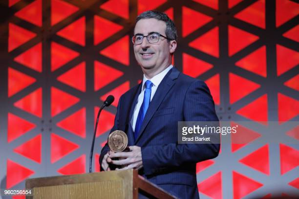 Comedian John Oliver of Last Week Tonight with John Oliver accepts Peabody award onstage during The 77th Annual Peabody Awards Ceremony at Cipriani...