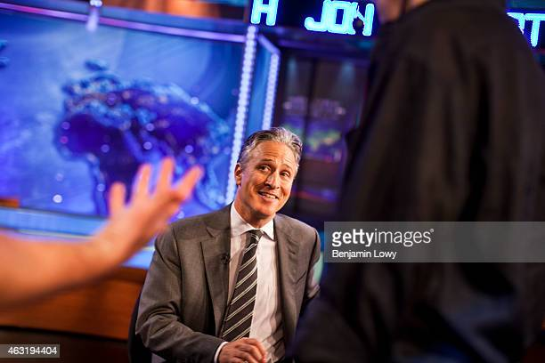 Comedian Jon Stewart host of Comedy Central's The Daily Show talks to his creative staff during a commerical break while recording a show on August 9...