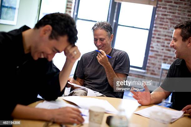 Comedian Jon Stewart host of Comedy Central's The Daily Show works with script writers in the show's writer's room on August 9 2011 in New York