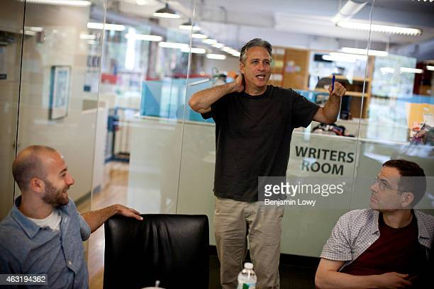 Comedian Jon Stewart host of Comedy Central's The Daily Show works with script writers in the show's 'writer's room' on August 9 2011 in New York