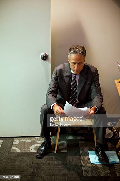 Comedian Jon Stewart host of Comedy Central's The Daily Show works with his main creative staff on script rewrites following a onset rehersal on...