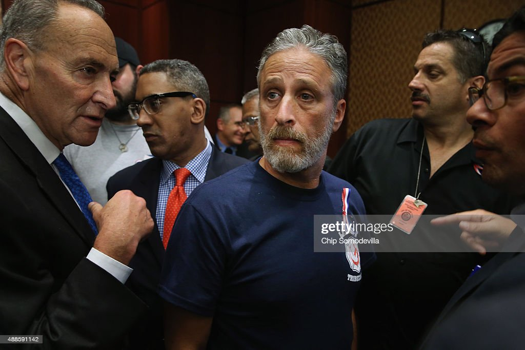 Comedian Jon Stewart joined ill first responders and politicians, including Sen. Chuck Schumer (D-NY) (L) for a news conference to demand an extension of the Zadroga 9/11 health bill at the U.S. Capitol September 16, 2015 in Washington, DC. The former Daily Show host joined ailing police and firefighters in lobbying Congress for a permanent extension of the Zadroga Act's $1.6 billion health and monitoring effort for the 72,000 emergency responders who worked at Ground Zero.