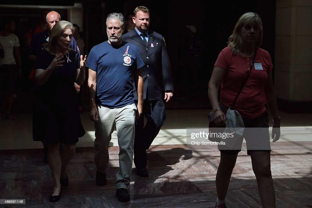 Comedian Jon Stewart (2nd L) joins Sen. Kirsten Gillibrand (D-NY) (L) while visiting the U.S. Capitol to demand that Congress extend the Zadroga 9/11 health bill September 16, 2015 in Washington, DC. The former Daily Show host joined ailing police and firefighters in lobbying Congress for a permanent extension of the Zadroga Act's $1.6 billion health and monitoring effort for the 72,000 emergency responders who worked at Ground Zero.