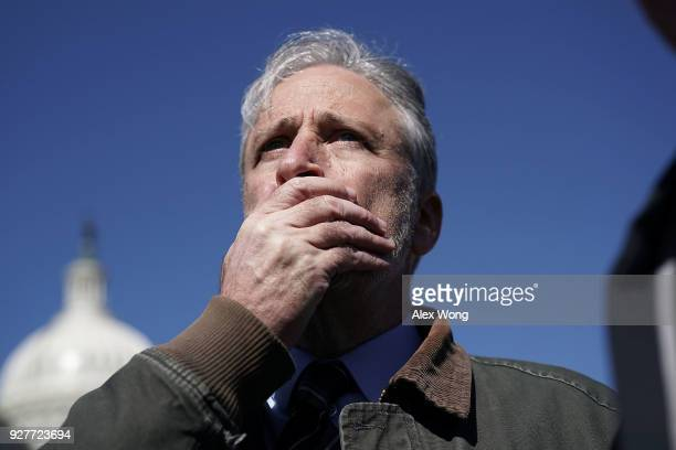Comedian Jon Stewart reacts as he talks to a member of the media after a news conference March 5 2018 on Capitol Hill in Washington DC Stewart took...