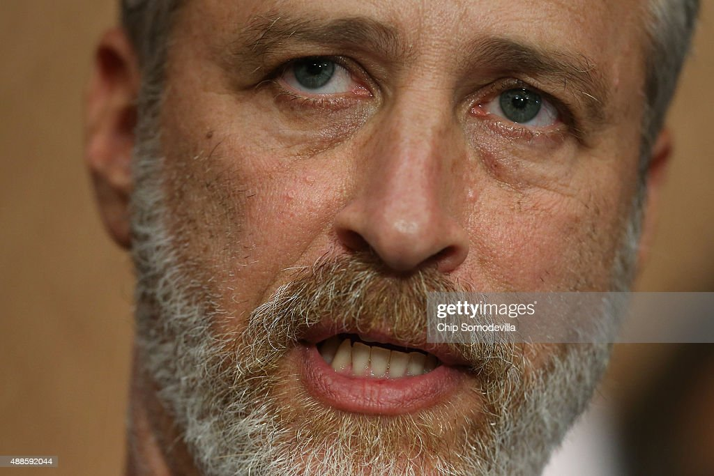 Comedian Jon Stewart (C) speaks during a news conference with members of Congress and ill first-responders to demand an extension of the Zadroga 9/11 health bill at the U.S. Capitol September 16, 2015 in Washington, DC. The former Daily Show host joined ailing police and firefighters in lobbying Congress for a permanent extension of the Zadroga Act's $1.6 billion health and monitoring effort for the 72,000 emergency responders who worked at Ground Zero.