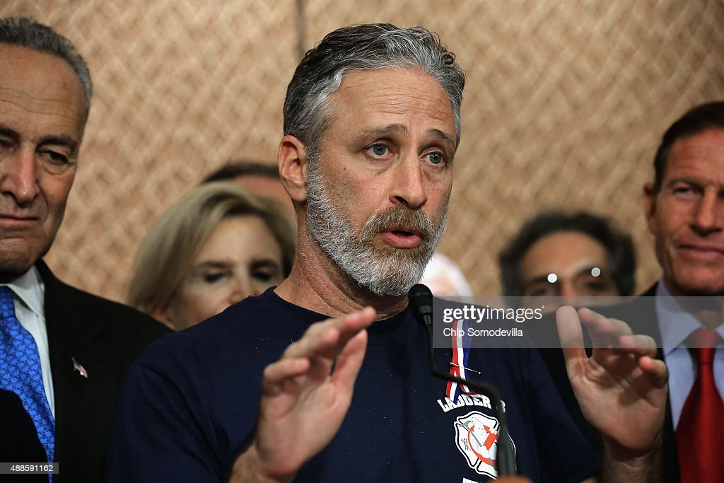 Comedian Jon Stewart (C) speaks during a news conference with Sen. Chuck Schumer (D-NY) (L), Sen. Richard Blumenthal (D-CT) and other members of Congress to demand an extension of the Zadroga 9/11 health bill at the U.S. Capitol September 16, 2015 in Washington, DC. The former Daily Show host joined ailing police and firefighters in lobbying Congress for a permanent extension of the Zadroga Act's $1.6 billion health and monitoring effort for the 72,000 emergency responders who worked at Ground Zero.